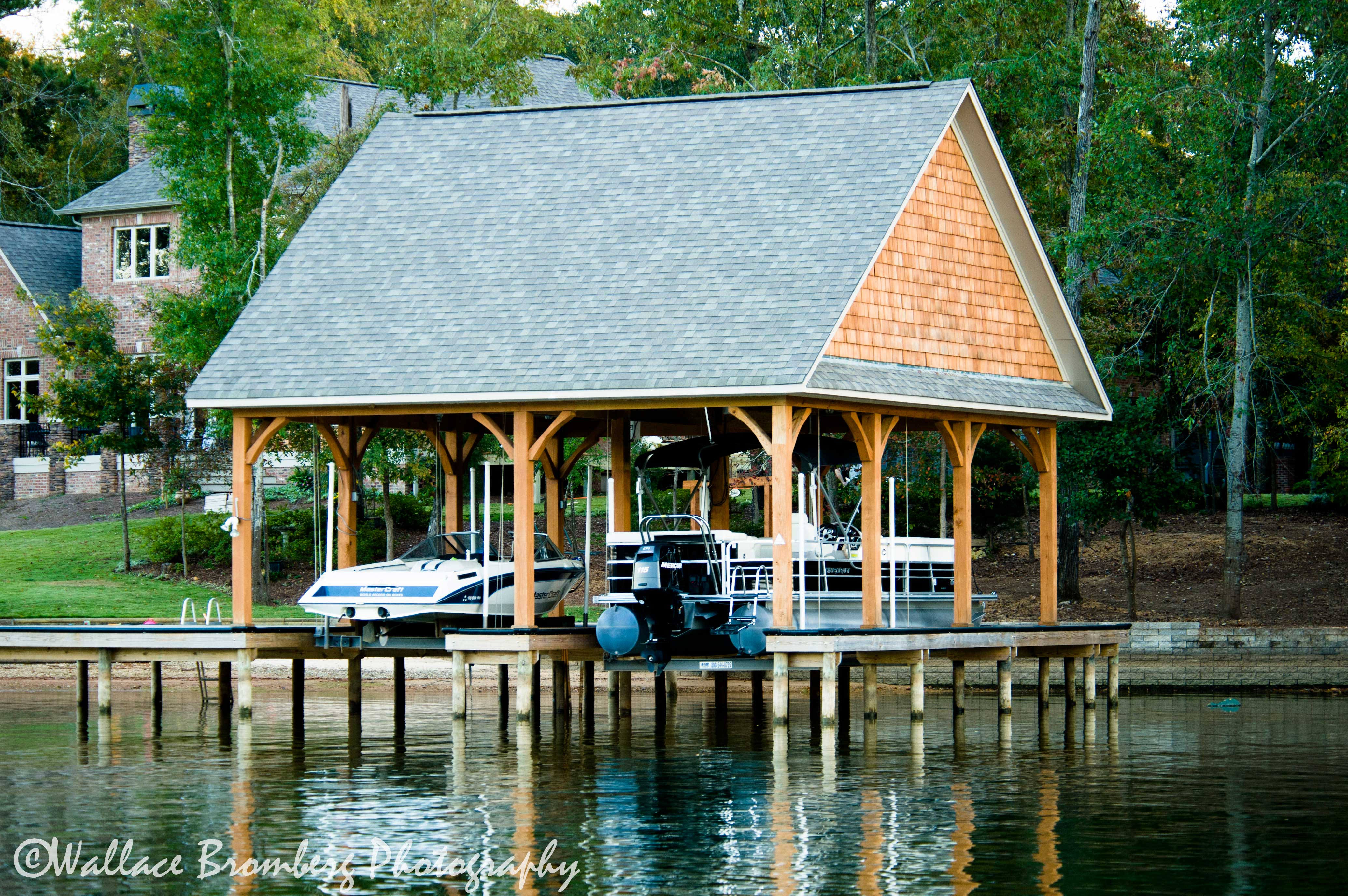 Boathouse lifts tradesman co for Boat house plans pictures